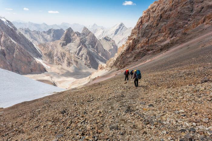 People trekking in Pamir Mountains