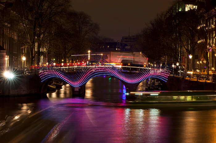 A city bridge decorated with lights during festival
