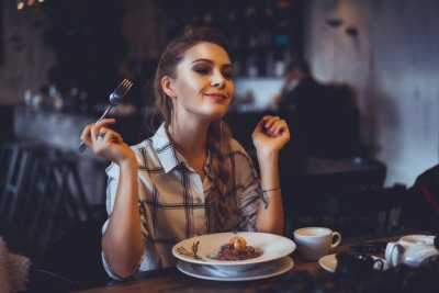 girl eating food in a restaurant