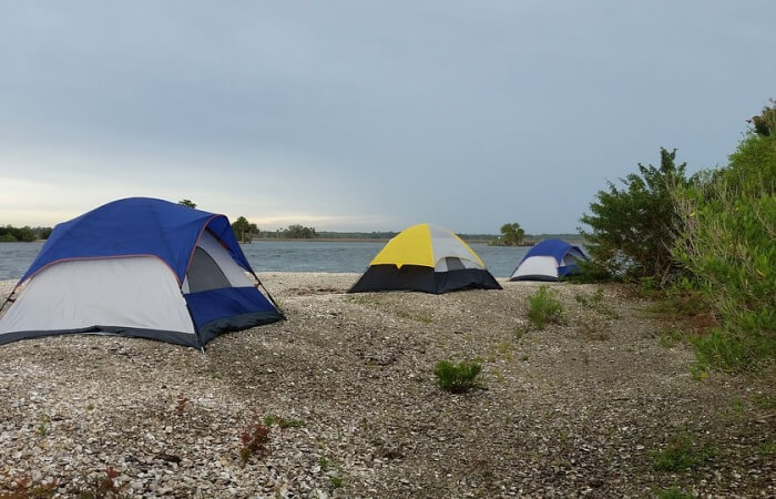 Camp on the beach to save accommodation fees