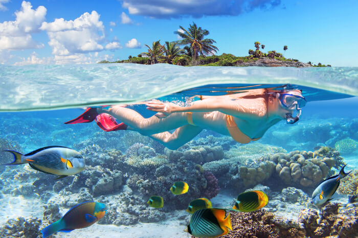 A woman snorkeling in Bahamas