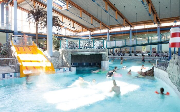people swimming in water park