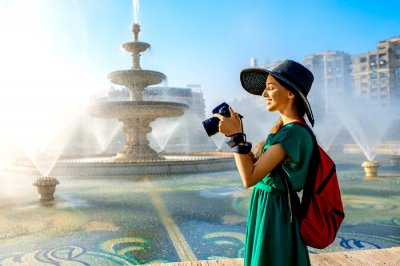 A girl with a camera in Bucharest