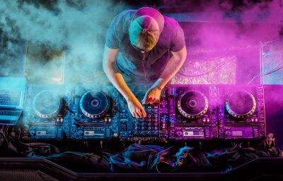 A DJ artist at his music console