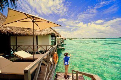 female traveler in maldives looking at the sea