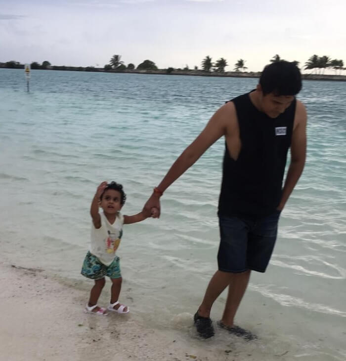 spending time with daughter on beach