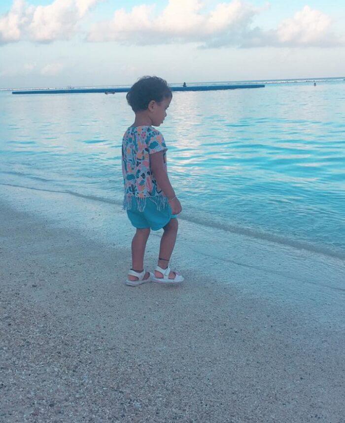 kid is having fun on the beach