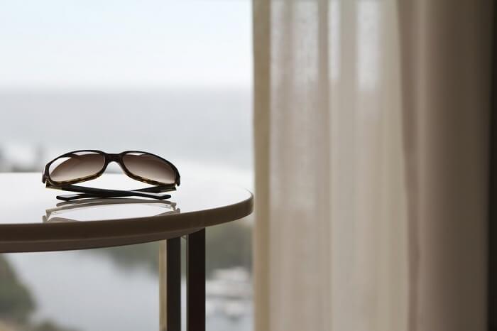 sunglasses in hotel room