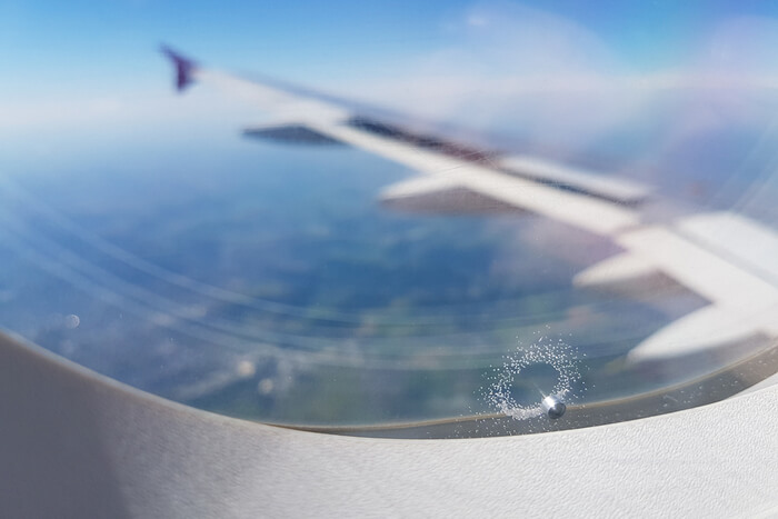 pressure release hole in airplane window